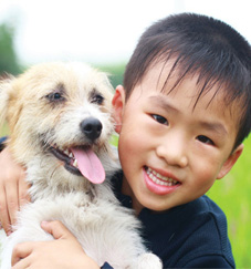Little boy with a dog