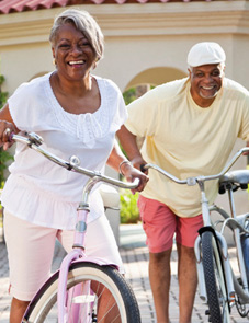 Woman and man riding bicycles