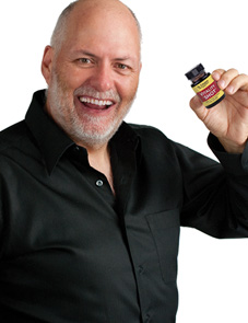 Dr. Schulze holding Vitality SHOT