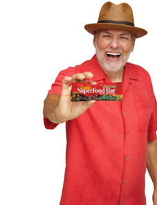Dr. Schulze holding Superfood Crunch Bar
